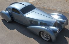 Type 57S Atlantic-inspired PACIFIC - For three years Terry Cook of Long Valley, New Jersey has been working on his latest creation. Inspired by the famed 1936-'38 BUGATTI Type 57S Atlantic, this carbon fiber and composite fiberglass bodied prototype is still undergoing the final finishing touches such as the chrome side trim, rivets in the external fins, etc, not shown in these photos, which are being completed in fall 2012. When finished, this first prototype car is FOR SALE.