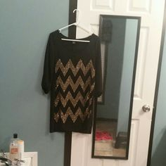 Black and gold chevron dress Medium. Perfect condition, fits like a small great with flats or boots!! Dresses Midi