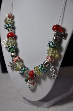 This is a Very stunning Christmas Necklace. It has 5 Charms, In the middle it features a very nice Snowman, and it's in full color! There is also these Silver charms- Snowflake, Christmas Tree, Stocking, and a Bell.   Along with many .925 Sterling beads.   If interested in this fine piece, please contact me- Hartline22@live.com
