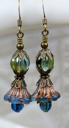 Bohemian dangle earrings with stunning iridescent blue green beads as well as a Czech glass bell flower bead makes a perfect unique gift for the Botanical lover.