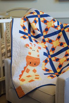 Georgie Giraffe Quilt Kit: A friendly giraffe peeks out through the patchwork on this sweet baby quilt designed by Deb Grogan.