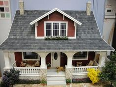 Bungalow dollhouse. So cute, down to the puppy on the porch. Photo credit: http://blog.realgoodtoys.com