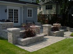 This looks nice with the planters. Could even put plants in top of columns.
