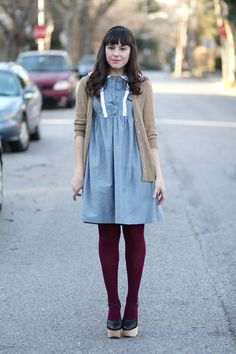 tick tock vintage.  love the plum tights and random colors.