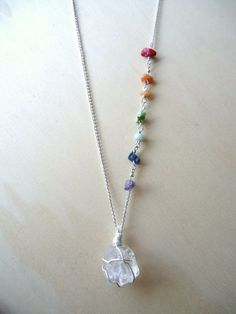 This 7 Chakra necklace was created to aid in balancing . A single raw clear quartz remains the focal piece of this necklace with 7 chakra chip bead stones lining the side of its chain. The quartz has been added to energize the other stones. Stone Jewelry, Wire Jewelry, Jewelry Crafts, Beaded Jewelry, Jewelery, Jewelry Necklaces, Handmade Jewelry, Bracelets, Necklace Ideas