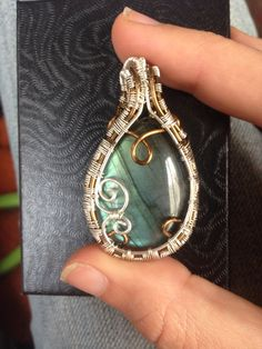 Labradorite raindrop pendant. Wrapped in silver and bronze. #wirewrap #handmadejewelry