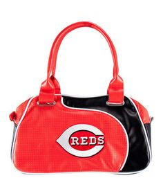 Set aside the glitz and glam and be a number one fan! This sweet satchel is emblazoned with a super-cool logo and proudly displays team colors. Bring everything along in spirited style!