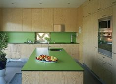 Formica®Laminate Leaf Green and Plywood make up this minimalistic kitchen.