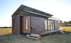 These shipping container homes are clad in quality timber and are suited for country or beach properties, according to the people selling… Container Home Designs, Shipping Container Design, Shipping Containers, Shipping Container Office, Container Cabin, Cargo Container, Container Buildings, Container Architecture, Sustainable Architecture