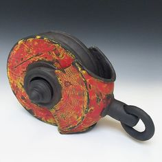 Hot out of the kiln. Red / Yellow Pulley. #ceramicsculpture #clay #claymechanics #blackstoneware