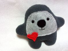Lovely  monster plushie with heart, 100% eco friendly. Handmade stuffed monster toy