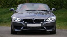 Bmw Convertible in Front of Green Bushes Bmw 116i, Bmw Z4, Bmw Convertible, Bmw M Power, Sports Illustrated Models, Motorcycle Manufacturers, Bmw Parts, Premium Cars, Autos