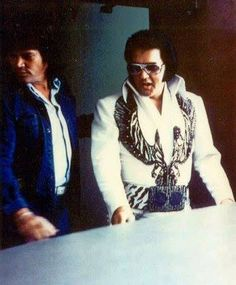 Sonny West and Elvis heading to his limo on his way to perform in Dallas on June 6, 1975