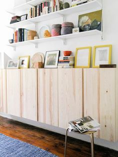 ikea cabinets for floating storage and wall shelves in an office