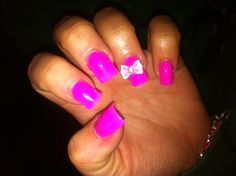 Hot pink nails with dimond pink bow