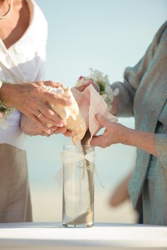 sand ceremony with conch shells, photo by luminairefoto.com
