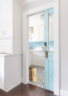Charming farmhouse laundry room with a turquoise blue vintage pocket door. Charming farmhouse laundry room with a turquoise blue vintage pocket door. Pantry Laundry Room, Laundry Room Doors, Laundry Room Remodel, Laundry Room Storage, Laundry Room Design, Farmhouse Laundry Rooms, Laundry In Kitchen, Kitchen Reno, Laundry Room Inspiration