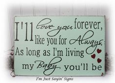 I'll Love You Forever I'll Like You For Always As Long As I'm Living My Baby You'll Be Wood Sign. $19.95, via Etsy.