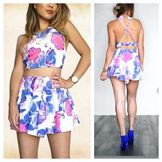 NWT Watercolor Floral Romper Set {Not LF tagged for style reference only!}Amazing set with a floral design. The bottom shorts are designed to look like a skirt. Has some small pleats at waist. Cinched elastic at waist and bottom bust. Top is backless and straps Criss cross. Lined and not see through! Amazing designer quality!!   Please message with questions   Similar styles- free people urban outfitters UO revolve clothing for love and lemons Tobi blue life Zara Lulus LF Pants Jumpsuits…