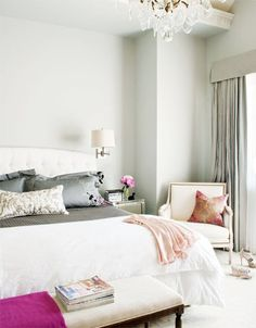 Gray walls are perfection in this bedroom.  Also like the crystal chandelier and the Louis XVI armchair!