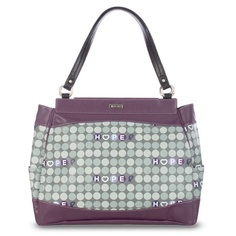 Hope (purple) for Prima    Perky and fresh, the Hope (purple) for Prima Bags lets you show your support for a great cause with light-hearted sweetness. Smooth grey faux leather with plum accents and delightful polka dots in varying shades of purple and gray. Catch the Spirit of Hope—a portion of every purchase of a Hope Shell goes directly to cancer research.    Base bag and handles not included