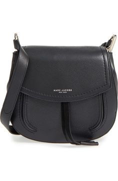 0752aeac15b This curvy shoulder bag by Marc Jacobs is done up in supple textured leather  and highlighted by signature metallic branding at the flap.