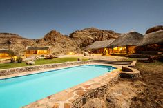 Canyon Village is nestled below the foot of a sweeping rock face in Gondwana Canyon Park, 27 km from the Fish River Canyon in Namibia. Quiver trees, Nama culture and a rugged landscape characterise Canyon Village, with its stone and thatch chalets positioned in a horse-shoe design around the quiver trees. Comfortable bed and breakfast accommodation is offered in 42 chalets.