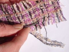 Creating trim.... Tease out the threads from the weave