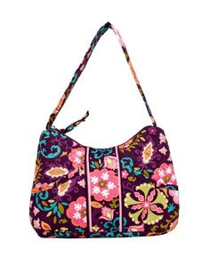 """Stephanie Dawn Susan handbag    Carry all your necessities in this tidy little hobo style purse.   Includes two front slide in pockets, one extending 6"""" wide, the other 3.25"""" wide – perfect to keep your phone and keys within quick reach. Find a full width, quilted zipper pocket on the back and one slide in pocket inside to help keep everything organized. Add a full zipper closure to keep it secure and you're all set to go.    Dimensions 7""""H x 9.25""""W x 2.75""""D     Strap Drop 8.25"""""""