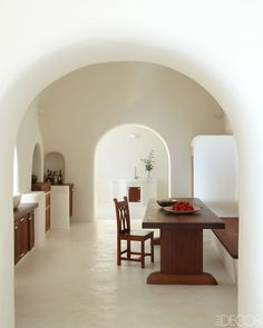 Dream Santorini home - the contrast between a dark wood and white walls is becoming a theme!