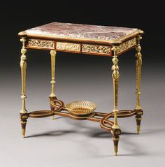 François Linke 1855 - 1946 A Louis XVI style gilt bronze mounted mahogany table ambulante, Paris, early 20th century, index number 114, after the celebrated model by Adam Weisweiler made for Marie-Antoinette