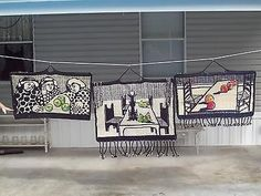 Mary Lou Higgins received a bachelor's degree in art with her major concentration being weaving. There are three weavings that hung in her home. They depict her three daughters in the first, a set of dining room furniture that she and her husband Woody made and also showing a metal candlestick on the table that Mary Lou also made. The weaving on the right depicts a still life.