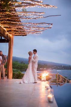 Gorgeous lighting.  Read more - http://www.stylemepretty.com/2013/09/13/kona-hawaii-wedding-from-toby-hoogs-photography-vintagelace-weddings/ #bodasenlaplaya