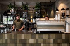 Olive raw tones pervade simple interior of High Noon Coffee Saloon by Robeson Architects - Foodielovin'