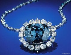 The Hope diamond is located in the Smithsonian Museum of Natural History in Washington DC. It looks blue in color to the naked eye because the number of traces of boron in the crystal structure, but it shines a red phosphor under ultraviolet light.