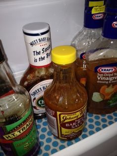 Fridge Coasters under the condiments.  Saves me from scrubbing the bins out,...love!