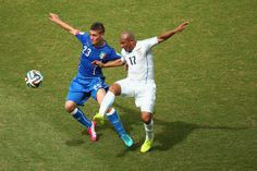 Marco Verratti of Italy and Egidio Arevalo Rios of Uruguay compete for the ball during the 2014 FIFA World Cup Brazil Group D match between ...