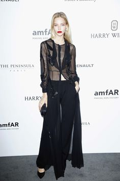 Trousers with a sheer robe top.