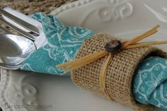 Turn Toilet Paper Tubes into Elegant Napkin Rings - maybe gray burlap with blue flowers