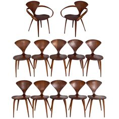 13,500 Set of 12 Plycraft Dining Chairs Designed by Norman Cherner | From a unique collection of antique and modern dining room chairs at http://www.1stdibs.com/furniture/seating/dining-room-chairs/