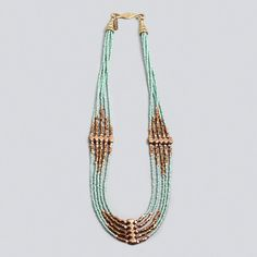 Sea Green Glass Bead, Gold Nugget and Brass Spacer Cascade Necklace -- the diamond shapes of the metal with the biggest metal beads at center lines