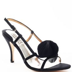 These adorable sandals from Badgley Mischka are sure to perfect your every fancy outfit. Raquel is a sandal in luxe black satin which wraps around the outside of the foot, ending in a cute fabric rose-like detail at the vamp of the shoe. A low 3 inch covered heel keeps these sandals reasonable for every imaginable occasion! http://www.amazon.com/dp/B002QGT8W2/?tag=icypnt-20