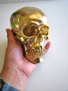 Skull Head in gold: Mr. Smiley. $35.00, via Etsy.
