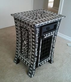 A DIY stenciled piece of furniture using the Indian Inlay Stencil pattern from Cutting Edge Stencils. http://www.cuttingedgestencils.com/indian-inlay-stencil-furniture.html