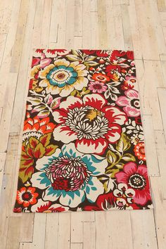 From Urban Outfitters - a wonderful bright rug for a family room (would really brighten up a basement room!)