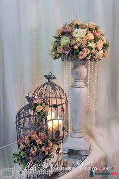 Vintage wedding decorations with birdcages, candles, and flowers