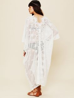 "Cotton crochet oversized maxi dress with ""V""-neckline in front and back. The perfect beach cover up!    *By Miguela   *100% Cotton   *Hand Wash Cold   *Import     Measurements for Size Small:   Length: 49 1/2""   Length Across Front Bust: 42""   Sleeve Length: 21 1/2""   Armhole Opening: 13"""
