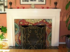 Fire Place Mosaic | Fran Charbeneau Design. Fran is a glass and mosaic artist. I want this fireplace! She is super talented.
