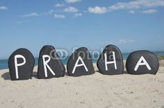 Praha, Czech Republic capital on black stones with beach background