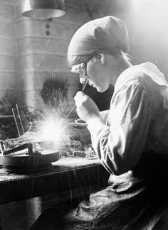A female acetylene welder at work in an aircraft factory in the Midlands, 1918., Lewis G P